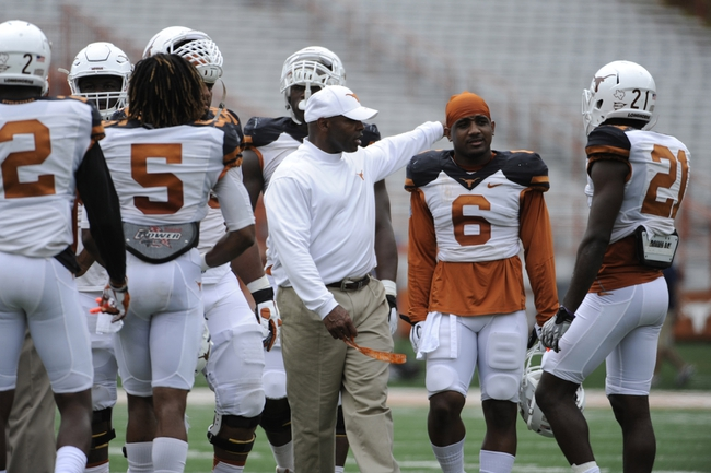Apr 19, 2014; Austin, TX, USA; Texas Longhorns head coach Charlie Strong reacts with corner back Quandre Diggs (6) during the Spring Game at Texas Memorial Stadium. Mandatory Credit: Brendan Maloney-USA TODAY Sports