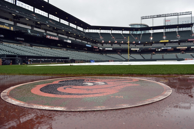 Apr 29, 2014; Baltimore, MD, USA; Rain builds up on the field after the game between the Pittsburgh Pirates and Baltimore Orioles was canceled due to rain at Oriole Park at Camden Yards.  Mandatory Credit: Tommy Gilligan-USA TODAY Sports