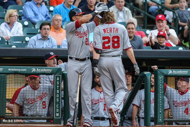 Apr 29, 2014; Houston, TX, USA; Washington Nationals shortstop Ian Desmond (20) removes the helmet of designated hitter Jayson Werth (28) after Werth hit a home run during the first inning against the Houston Astros at Minute Maid Park. Mandatory Credit: Troy Taormina-USA TODAY Sports