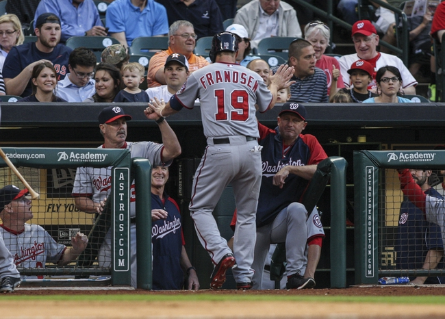 Apr 29, 2014; Houston, TX, USA; Washington Nationals left fielder Kevin Frandsen (19) is congratulated after scoring a run during the third inning against the Houston Astros at Minute Maid Park. Mandatory Credit: Troy Taormina-USA TODAY Sports