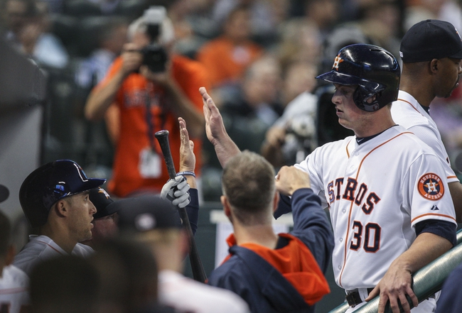 Apr 29, 2014; Houston, TX, USA; Houston Astros third baseman Matt Dominguez (30) is congratulated after scoring a run during the third inning against the Washington Nationals at Minute Maid Park. Mandatory Credit: Troy Taormina-USA TODAY Sports