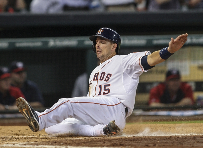 Apr 29, 2014; Houston, TX, USA; Houston Astros catcher Jason Castro (15) slides safely to score a run during the third inning against the Washington Nationals at Minute Maid Park. Mandatory Credit: Troy Taormina-USA TODAY Sports