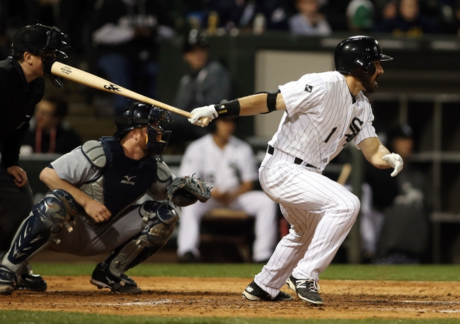 Apr 29, 2014; Chicago, IL, USA; Chicago White Sox center fielder Adam Eaton (1) hits a RBI double against the Detroit Tigers in the third inning at U.S Cellular Field. Mandatory Credit: Jerry Lai-USA TODAY Sports
