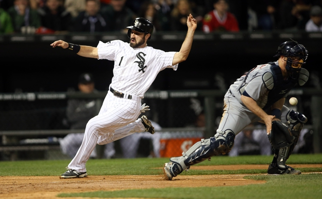 Apr 29, 2014; Chicago, IL, USA; Chicago White Sox center fielder Adam Eaton (1) scores a run as Detroit Tigers catcher Bryan Holaday (right) bobbles the ball in the third inning at U.S Cellular Field. Mandatory Credit: Jerry Lai-USA TODAY Sports