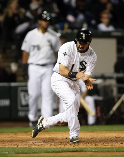 Apr 29, 2014; Chicago, IL, USA; Chicago White Sox center fielder Adam Eaton (1) reacts after scoring a run against the Detroit Tigers in the third inning at U.S Cellular Field. Mandatory Credit: Jerry Lai-USA TODAY Sports