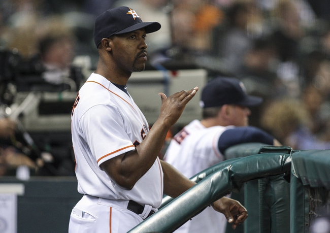 Apr 29, 2014; Houston, TX, USA; Houston Astros manager Bo Porter (16) signals from the dugout during the fourth inning against the Washington Nationals at Minute Maid Park. Mandatory Credit: Troy Taormina-USA TODAY Sports
