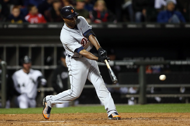 Apr 29, 2014; Chicago, IL, USA; Detroit Tigers right fielder Torii Hunter hits a RBI single against the Chicago White Sox in the sixth inning at U.S Cellular Field. Mandatory Credit: Jerry Lai-USA TODAY Sports