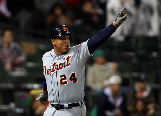 Apr 29, 2014; Chicago, IL, USA; Detroit Tigers first baseman Miguel Cabrera reacts after scoring a run against the Chicago White Sox in the sixth inning at U.S Cellular Field. Mandatory Credit: Jerry Lai-USA TODAY Sports