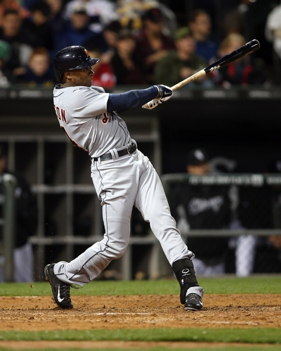 Apr 29, 2014; Chicago, IL, USA; Detroit Tigers center fielder Austin Jackson (14) hits a RBI single against the Chicago White Sox in the sixth inning at U.S Cellular Field. Mandatory Credit: Jerry Lai-USA TODAY Sports