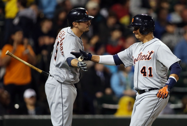 Apr 29, 2014; Chicago, IL, USA; Detroit Tigers designated hitter Victor Martinez (41) celebrates with third baseman Nick Castellanos (9) after scoring a run against the Chicago White Sox in the sixth inning at U.S Cellular Field. Mandatory Credit: Jerry Lai-USA TODAY Sports