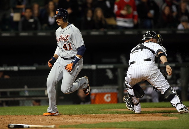 Apr 29, 2014; Chicago, IL, USA; Detroit Tigers designated hitter Victor Martinez (left) scores a run past Chicago White Sox catcher Tyler Flowers (right) in the sixth inning at U.S Cellular Field. Mandatory Credit: Jerry Lai-USA TODAY Sports
