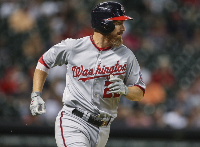 Apr 29, 2014; Houston, TX, USA; Washington Nationals first baseman Adam LaRoche (25) drives in a run with a hit during the eighth inning against the Houston Astros at Minute Maid Park. Mandatory Credit: Troy Taormina-USA TODAY Sports