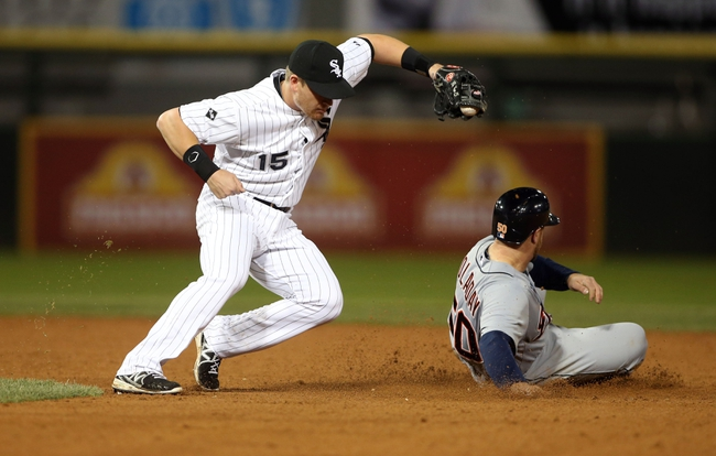 Apr 29, 2014; Chicago, IL, USA; Detroit Tigers catcher Bryan Holaday (50) steals second base ahead of the tag by Chicago White Sox second baseman Gordon Beckham (15) in the eighth inning at U.S Cellular Field. Mandatory Credit: Jerry Lai-USA TODAY Sports