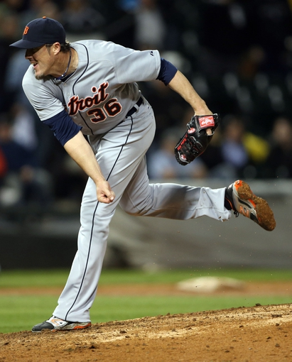 Apr 29, 2014; Chicago, IL, USA; Detroit Tigers relief pitcher Joe Nathan (36) throws a pitch against the Chicago White Sox in the ninth inning at U.S Cellular Field. Mandatory Credit: Jerry Lai-USA TODAY Sports