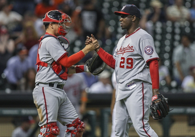 Apr 29, 2014; Houston, TX, USA; Washington Nationals catcher Jose Lobaton (59) and relief pitcher Rafael Soriano (29) celebrate after defeating the Houston Astros 4-3 at Minute Maid Park. Mandatory Credit: Troy Taormina-USA TODAY Sports