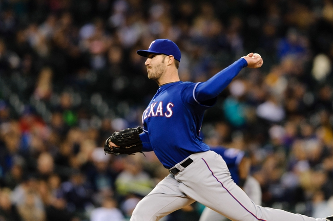 Apr 26, 2014; Seattle, WA, USA; Texas Rangers relief pitcher Aaron Poreda (49) pitches to the Seattle Mariners during the game at Safeco Field. Texas defeated Seattle 6-3. Mandatory Credit: Steven Bisig-USA TODAY Sports
