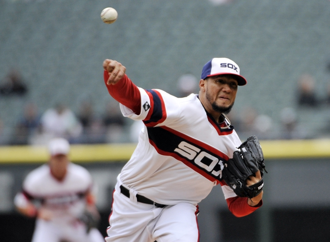 Apr 30, 2014; Chicago, IL, USA;  Chicago White Sox starting pitcher Hector Noesi (48) pitches against the Detroit Tigers during the first inning at U.S Cellular Field. Mandatory Credit: David Banks-USA TODAY Sports