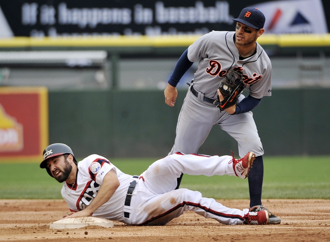 Apr 30, 2014; Chicago, IL, USA; Chicago White Sox center fielder Adam Eaton (1) is safe at second base as Detroit Tigers second baseman Ian Kinsler (3) takes the throw during the third inning at U.S Cellular Field. Mandatory Credit: David Banks-USA TODAY Sports