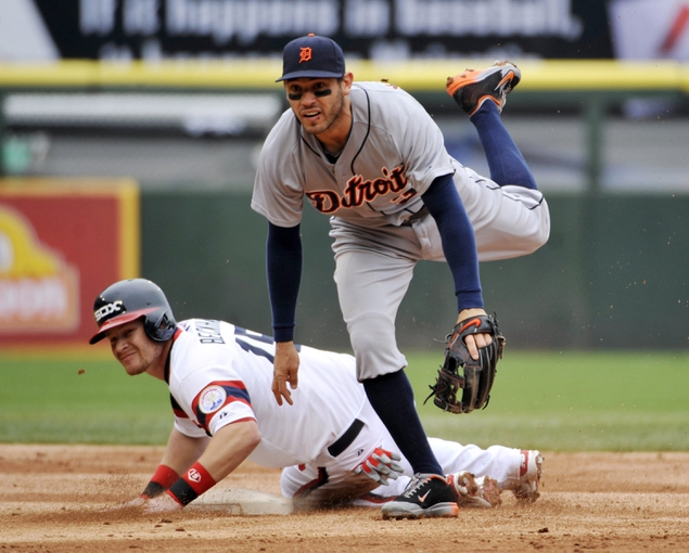 Apr 30, 2014; Chicago, IL, USA; Detroit Tigers second baseman Ian Kinsler (3) forces out Chicago White Sox second baseman Gordon Beckham (15) during the third inning at U.S Cellular Field. Mandatory Credit: David Banks-USA TODAY Sports