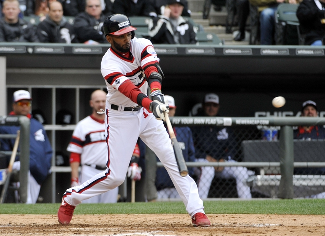 Apr 30, 2014; Chicago, IL, USA; Chicago White Sox shortstop Alexei Ramirez (10) hits a single against the Detroit Tigers during the fifth inning at U.S Cellular Field. Mandatory Credit: David Banks-USA TODAY Sports