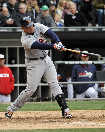 Apr 30, 2014; Chicago, IL, USA;  Detroit Tigers first baseman Miguel Cabrera (24) hits a single against the Chicago White Sox during the eighth inning at U.S Cellular Field. The Detroit Tigers defeated the Chicago White Sox 5-1. Mandatory Credit: David Banks-USA TODAY Sports