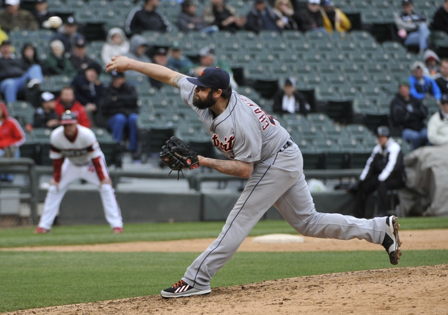 Apr 30, 2014; Chicago, IL, USA; Detroit Tigers pitcher Joba Chamberlain throws a pitch against the Chicago White Sox at U.S Cellular Field. The Detroit Tigers defeated the Chicago White Sox 5-1. Mandatory Credit: David Banks-USA TODAY Sports