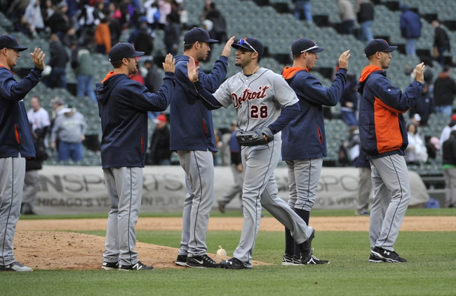 Apr 30, 2014; Chicago, IL, USA;  Detroit Tigers left fielder J.D. Martinez  (28) is greeted by teammates after the win against the Chicago White Sox at U.S Cellular Field. The Detroit Tigers defeated the Chicago White Sox 5-1. Mandatory Credit: David Banks-USA TODAY Sports