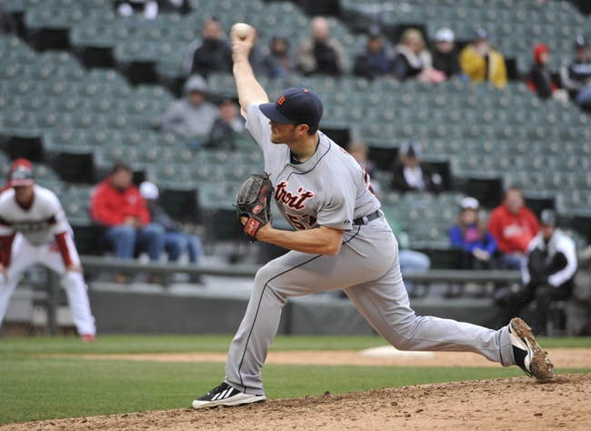 Apr 30, 2014; Chicago, IL, USA;  Detroit Tigers relief pitcher Evan Reed (57) pitches against the Chicago White Sox during the ninth inning at U.S Cellular Field. The Detroit Tigers defeated the Chicago White Sox 5-1. Mandatory Credit: David Banks-USA TODAY Sports