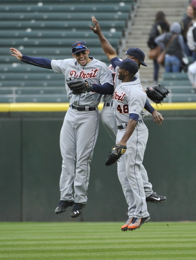 Apr 30, 2014; Chicago, IL, USA;  Detroit Tigers left fielder J.D. Martinez (28) center fielder Austin Jackson (14) and right fielder Torii Hunter (48)  celebrate their win over the Chicago White Sox at U.S Cellular Field. The Detroit Tigers defeated the Chicago White Sox 5-1. Mandatory Credit: David Banks-USA TODAY Sports