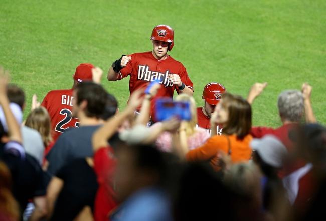 Apr 30, 2014; Phoenix, AZ, USA; Arizona Diamondbacks infielder Chris Owings is congratulated after scoring in the ninth inning against the Colorado Rockies at Chase Field. Mandatory Credit: Mark J. Rebilas-USA TODAY Sports