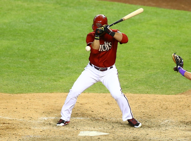 Apr 30, 2014; Phoenix, AZ, USA; Arizona Diamondbacks outfielder Gerardo Parra is hit by a pitch in the ninth inning against the Colorado Rockies at Chase Field. Mandatory Credit: Mark J. Rebilas-USA TODAY Sports