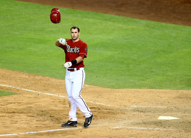 Apr 30, 2014; Phoenix, AZ, USA; Arizona Diamondbacks first baseman Paul Goldschmidt throws his helmet as he reacts after striking out in the ninth inning against the Colorado Rockies at Chase Field. Mandatory Credit: Mark J. Rebilas-USA TODAY Sports