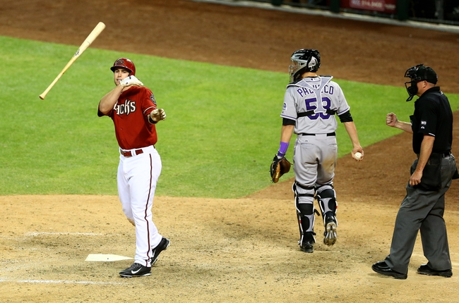 Apr 30, 2014; Phoenix, AZ, USA; Arizona Diamondbacks first baseman Paul Goldschmidt throws his bat as he reacts after striking out in the ninth inning against the Colorado Rockies at Chase Field. Mandatory Credit: Mark J. Rebilas-USA TODAY Sports