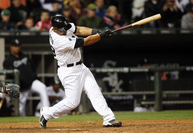 Apr 29, 2014; Chicago, IL, USA; Chicago White Sox first baseman Jose Abreu at bat against the Detroit Tigers at U.S Cellular Field. Mandatory Credit: Jerry Lai-USA TODAY Sports