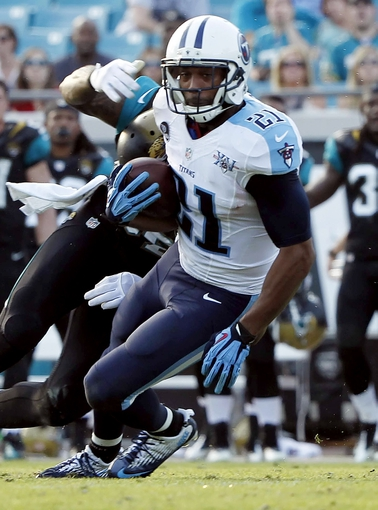 Dec 22, 2013; Jacksonville, FL, USA; Tennessee Titans free safety George Wilson (21) catches the ball for an interception against the Jacksonville Jaguars during the second half at EverBank Field. Tennessee Titans defeated the Jacksonville Jaguars 20-16.  Mandatory Credit: Kim Klement-USA TODAY Sports