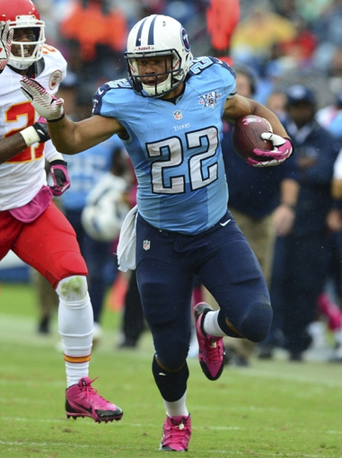 Oct 6, 2013; Nashville, TN, USA; Tennessee Titans running back Jackie Battle (22) carries the ball against the Kansas City Chiefs during the first half at LP Field. The Chiefs beat the Titans 26-17. Mandatory Credit: Don McPeak-USA TODAY Sports