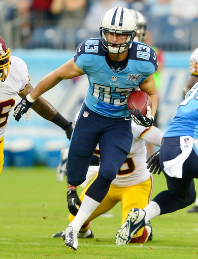 Aug 8, 2013; Nashville, TN, USA; Tennessee Titans wide receiver Marc Mariani (83) returns a kick against the Washington Redskins during the first half at LP Field. Mandatory Credit: Don McPeak-USA TODAY Sports