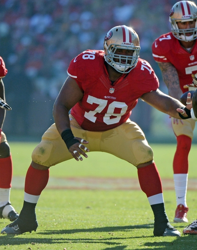 December 1, 2013; San Francisco, CA, USA; San Francisco 49ers guard Joe Looney (78) blocks against a St. Louis Rams defensive tackle during the first quarter at Candlestick Park. The 49ers defeated the Rams 23-13. Mandatory Credit: Kyle Terada-USA TODAY Sports