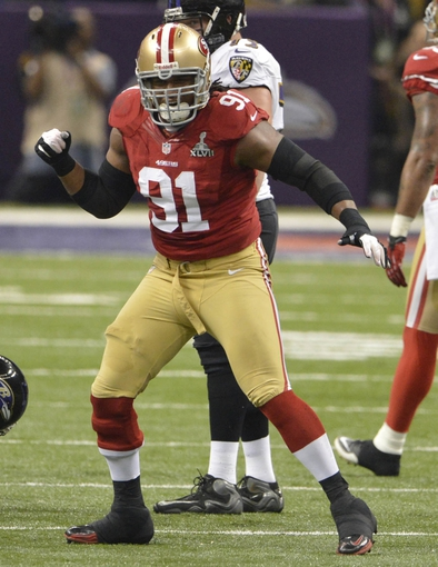 Feb 3, 2013; New Orleans, LA, USA; San Francisco 49ers defensive end Ray McDonald (91) celebrates sacking the Baltimore Ravens quarterback during the first quarter in Super Bowl XLVII at the Mercedes-Benz Superdome. Mandatory Credit: Kirby Lee-USA TODAY Sports