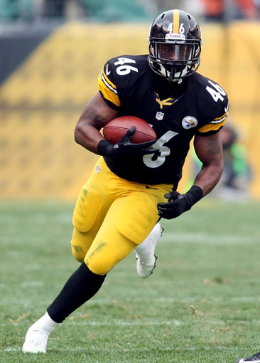 December 30, 2012; Pittsburgh, PA, USA; Pittsburgh Steelers fullback Will Johnson (46) carries the ball against a Cleveland Browns cornerback during the third quarter at Heinz Field. The Pittsburgh Steelers won 24-10. Mandatory Credit: Charles LeClaire-USA TODAY Sports