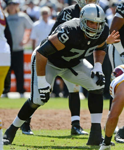 September 29, 2013; Oakland, CA, USA; Oakland Raiders tackle Tony Pashos (79) stands at the line of scrimmage during the first quarter against the Washington Redskins at O.co Coliseum. The Redskins defeated the Raiders 24-14. Mandatory Credit: Kyle Terada-USA TODAY Sports