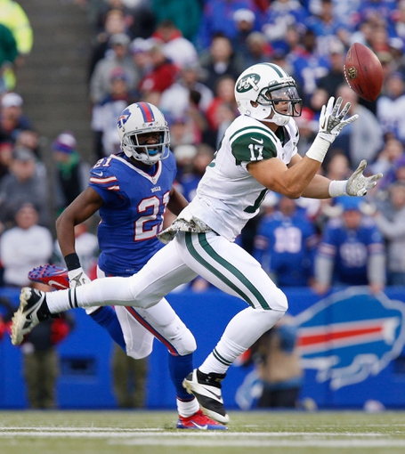 Nov 17, 2013; Orchard Park, NY, USA; New York Jets wide receiver Vidal Hazelton (17) catches a pass while being covered by a Buffalo Bills cornerback during the second half at Ralph Wilson Stadium. Bills beat the Jets 37-14. Mandatory Credit: Kevin Hoffman-USA TODAY Sports