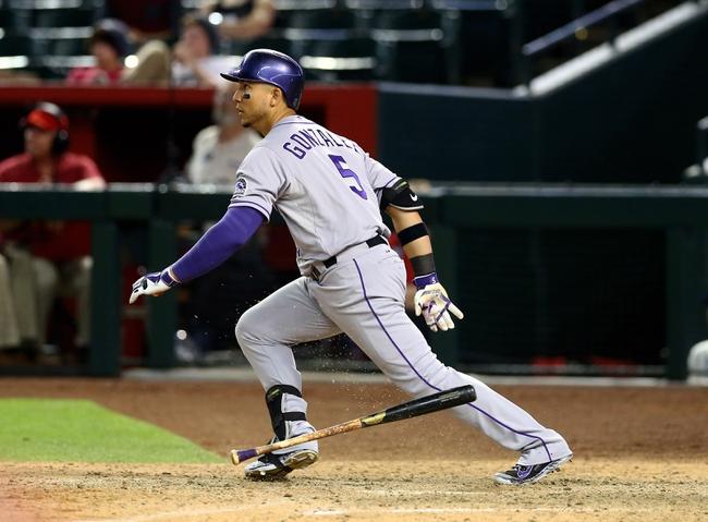 Apr 30, 2014; Phoenix, AZ, USA; Colorado Rockies outfielder Carlos Gonzalez against the Arizona Diamondbacks at Chase Field. Mandatory Credit: Mark J. Rebilas-USA TODAY Sports