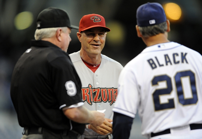 May 2, 2014; San Diego, CA, USA; Arizona Diamondbacks manager Kirk Gibson talks with San Diego Padres manager Bud Black (20) prior to the game at Petco Park. Mandatory Credit: Christopher Hanewinckel-USA TODAY Sports