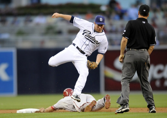 May 2, 2014; San Diego, CA, USA; San Diego Padres second baseman Jedd Gyorko (9) is unable to make a play on a stolen base by Arizona Diamondbacks right fielder Gerardo Parra (8) during the first inning at Petco Park. Mandatory Credit: Christopher Hanewinckel-USA TODAY Sports
