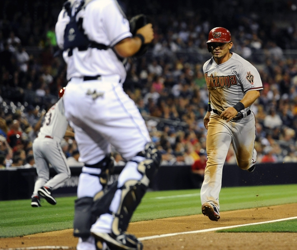 May 2, 2014; San Diego, CA, USA; Arizona Diamondbacks right fielder Gerardo Parra (8) scores during the third inning against the San Diego Padres at Petco Park. Mandatory Credit: Christopher Hanewinckel-USA TODAY Sports
