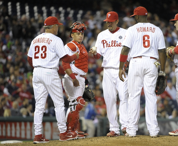 May 2, 2014; Philadelphia, PA, USA; Philadelphia Phillies relief pitcher Mike Adams (37) hands the ball to Philadelphia Phillies manager Ryne Sandberg (23) in the eighth inning against the Washington Nationals at Citizens Bank Park. The Nationals defeated the Phillies, 5-3. Mandatory Credit: Eric Hartline-USA TODAY Sports