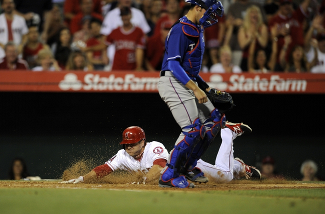 May 2, 2014; Anaheim, CA, USA; Los Angeles Angels left fielder J.B. Shuck (3) dives into home off of a single hit by Los Angeles Angels second baseman Howie Kendrick (not pictured) against the Texas Rangers during the fourth inning at Angel Stadium of Anaheim. Mandatory Credit: Kelvin Kuo-USA TODAY Sports