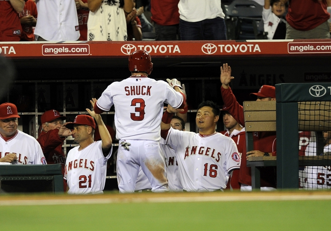 May 2, 2014; Anaheim, CA, USA; Los Angeles Angels left fielder J.B. Shuck (3) celebrates after running in a score off of a single hit by Los Angeles Angels second baseman Howie Kendrick (not pictured) against the Texas Rangers during the fourth inning at Angel Stadium of Anaheim. Mandatory Credit: Kelvin Kuo-USA TODAY Sports