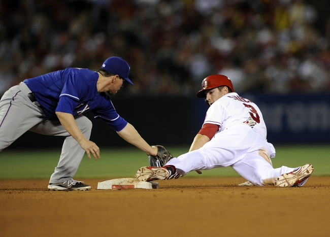 May 2, 2014; Anaheim, CA, USA; Los Angeles Angels left fielder J.B. Shuck (3) looks back at his foot after he steals second base in front of Texas Rangers second baseman Donnie Murphy (16) during the fourth inning at Angel Stadium of Anaheim. Mandatory Credit: Kelvin Kuo-USA TODAY Sports